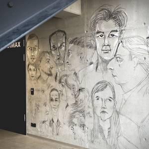 Porträtskizzen an einer Betonwand